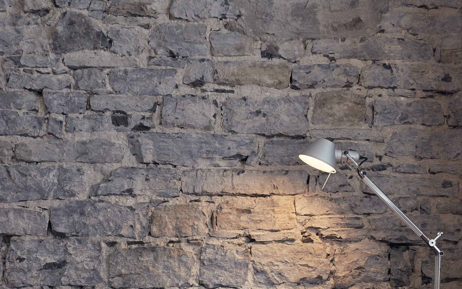 Comfort Room Details - Desk Lamp against stone wall